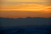 Солнце садится за хребет Тянь-Шаня. Вид с горы Дракона.