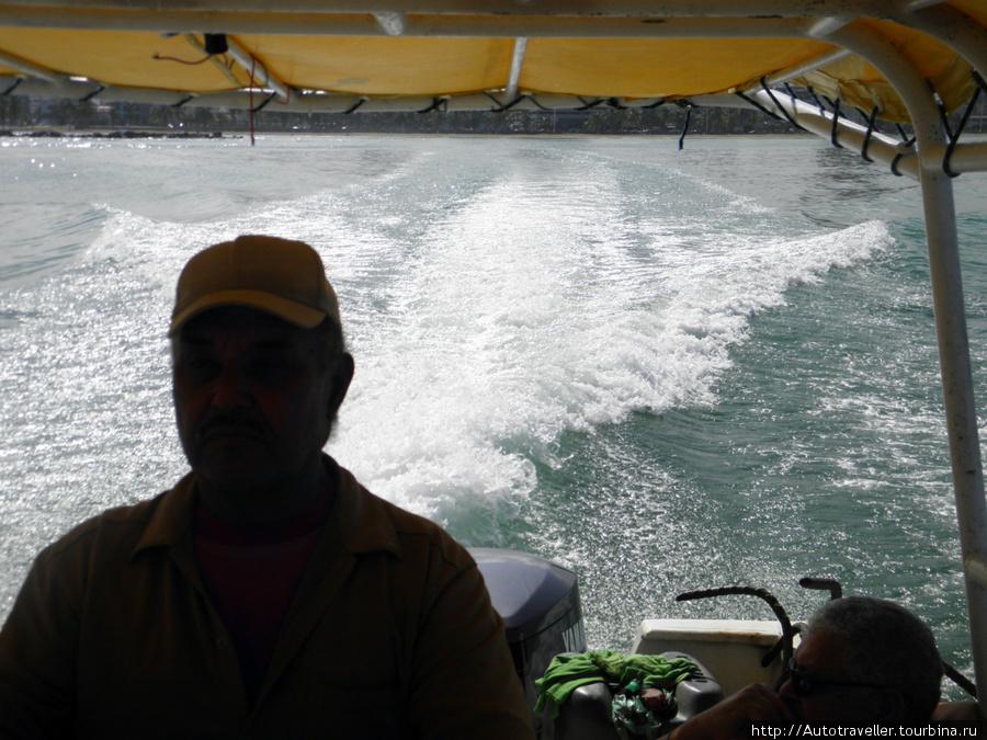 Puerto la Kruz.  eto mi´poexali na ostrova. Nash capitan.