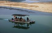 Туристический кораблик на реке Лицзян