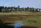 Река Молога и деревенские дома в Бежецке