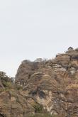 На верхушке горы храм бога пульке Тепостекателя (пульке — спиртной напиток из агавы типа бражки). Храм построен в виде пирамиды.