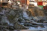 Вдоль реки расположены фумаролы, из которых и вырывается пар.