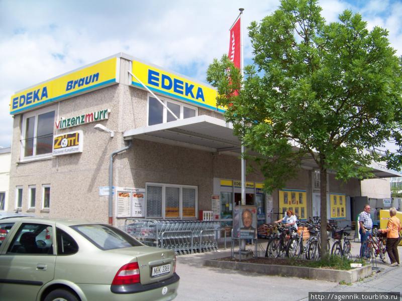 Вывестка сети Edeka — у E-Markt те же фирменные цвета и шрифт.