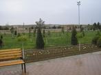 Центральная аллея в комплексе. На заднем плане, за земляным валом Афганистан.