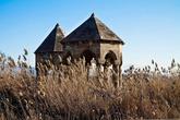 Чудом уцелевшие, как мне кажется, армянские постройки. Среди поросшей травы в поле за забором. На табличках имена похороненных турок и датировка 18ым веком.