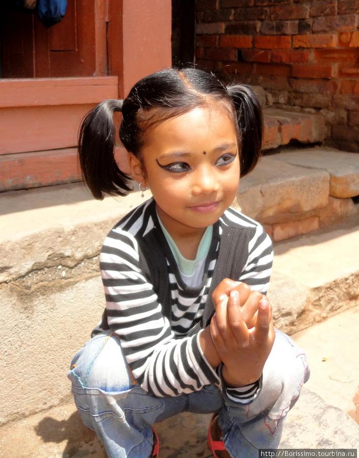 А эта маленькая красавица наверняка будущая звезда Болливуда :-).