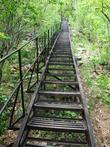 Первая покоренная вершина нацпарка — Двуглавая сопка. Дорога к ней начинается с железного моста, глядя на который думаешь, что прямо по лестнице дойдешь до высоты в 1034 метра. Ан, нет! Еще несколько километров по камням, откосам, долгим отдыхам и желанию плюнуть на все и вернуться назад.