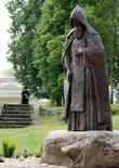Преподобный Нил Столобенский родился в конце XV столетия, недалеко от Великого Новгорода. Как его звали в миру, сейчас уже неизвестно, как и то, кем были его родители. Известно только, что после их смерти он отправился в Иоанно-Богословский Крыпецкий монастырь, который находился около Пскова. Там он принял постриг под именем Нил, в честь преподобного Нила Постника. В 1515 году преподобный Нил покинул Крыпецкий монастырь и срубил в лесу, во Ржевском уезде у реки Серемхи, небольшую келью. Жил уединённо, питался травами и дубовыми желудями, всё время проводил в молитвах. По преданию, в один из дней к преподобному Нилу пришли разбойники, решившие его убить. Однако он, сотворив молитву, вышел к ним с иконой Пресвятой Богородицы. Разбойникам привиделось, что преподобный окружён множеством вооружённых людей. В ужасе они упали к его ногам, раскаялись и стали просить прощения.